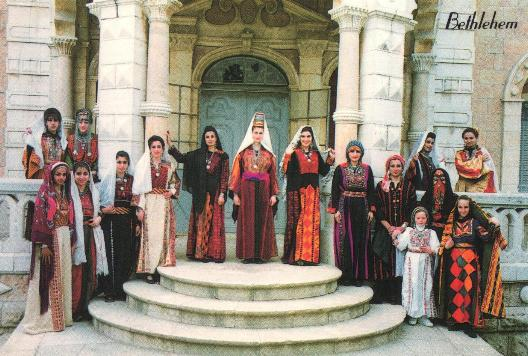 Postcard of a variety of Palestinian regional costume (pre 1948) from the collection of Maha Saca, Director, Palestinian Heritage Centre, Bethlehem